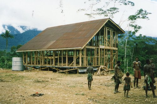 Construction of our second jungle home in the mountains at Malaumanda. All wood was cut from local trees and slabbed into lumber with a chainsaw.