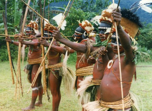 Two art forms: Unique ceremonial dress and shooting arrows with tribal bows.